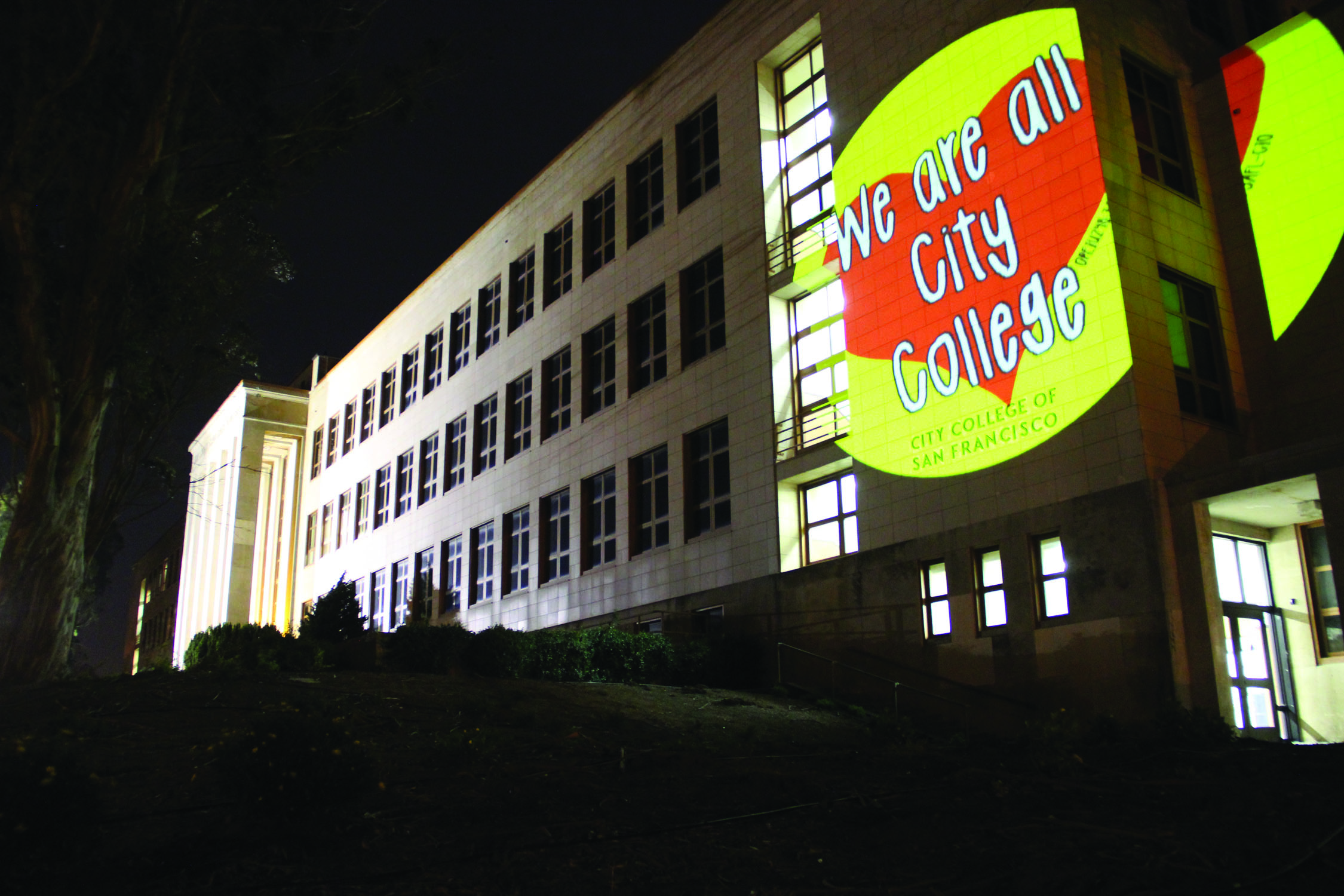 Community support lights up the side of CCSF's Science Building. Courtesy of the San Francisco Projection Department.