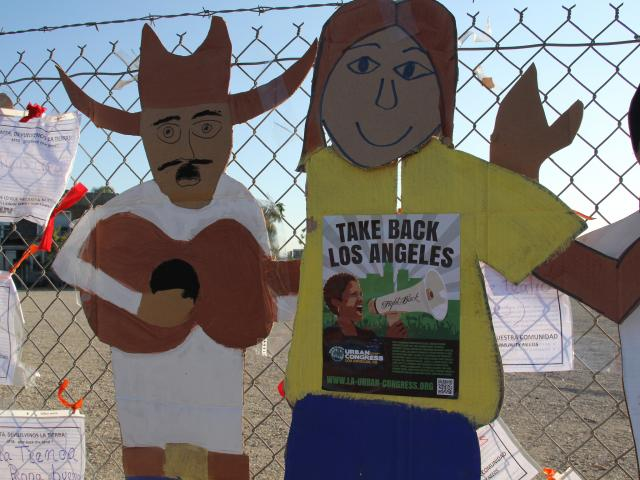 Cardboard cutouts on the fenced MTA?lot at the Take Back LA! march and rally, September 13, 2012. ©2012 Sharis Delgadillo