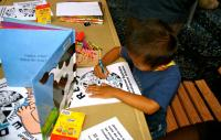 A child coloring at the REDI Forum, July 2007.  ©2007 Urban Habitat
