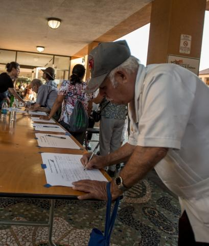 Signing in at East San Jose community meeting © 2015 Tiburon