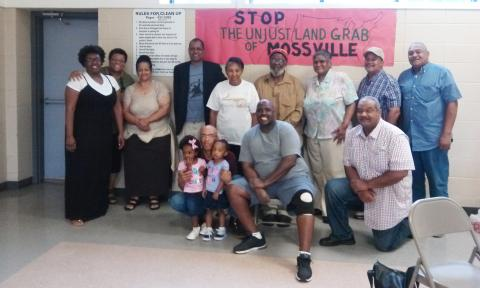 The stalwart residents who carry on the fight. Left to right back row: Ericka Jackson, Monique Harden, Christine Bennett, Desmond D'Sa, Dorothy Felix, Delma Bennett, Gail Garrett, Larry Allison, Ronald Carrier. Front row (left to right) Errol Hartman, Van Jackson and Karl Prater.